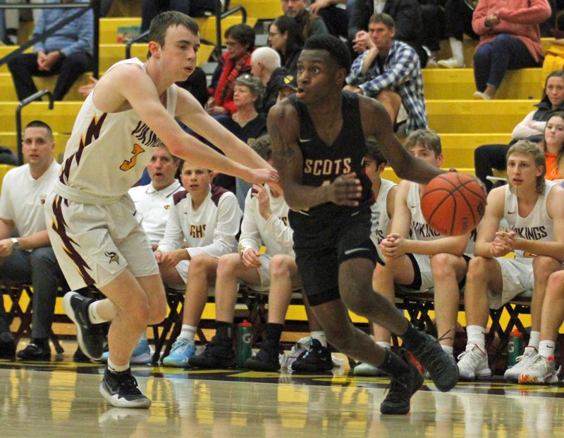 PMG PHOTO: WADE EVANSON - David Douglas Jermaine Robinson drives the baseline during Fridays 64-63 win at Forest Grove.