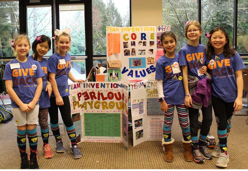 PMG PHOTO: ASIA ALVAREZ ZELLER - Lake Oswego River Grove robotics team 'Invention' poses for a photo in front of their display.