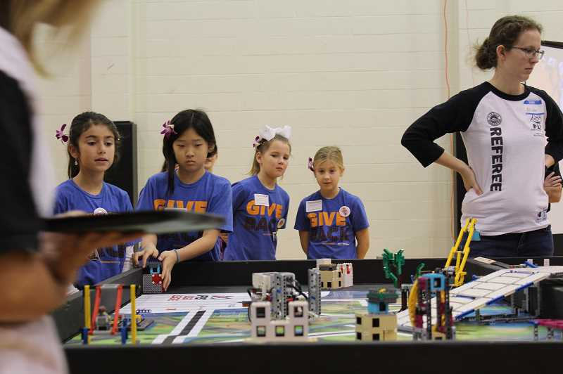 PMG PHOTO: ASIA ALVAREZ ZELLER - 'Invention' positions their robot on the game table.