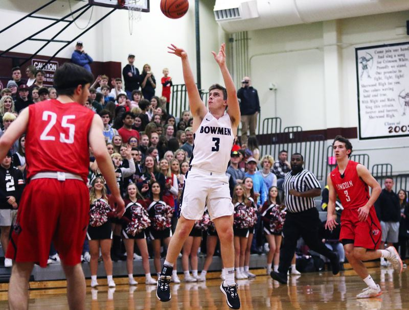 PMG PHOTO: DAN BROOD - Sherwood High School junior Caden Davis (3) shoots a 3-pointer during the first quarter of the Bowmen's 66-40 win over Lincoln on Friday.