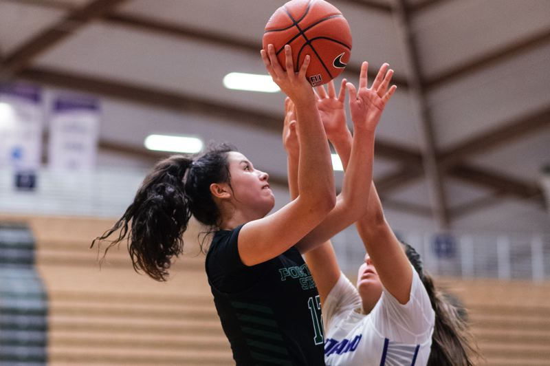 PMG PHOTO: CHRISTOPHER OERTELL - Portland State's Tatian Streun shoots for two of her 12 second-half points that helped the Vikings rally from a 15-point deficit to beat Portland 77-71 on Sunday at the Chiles Center.