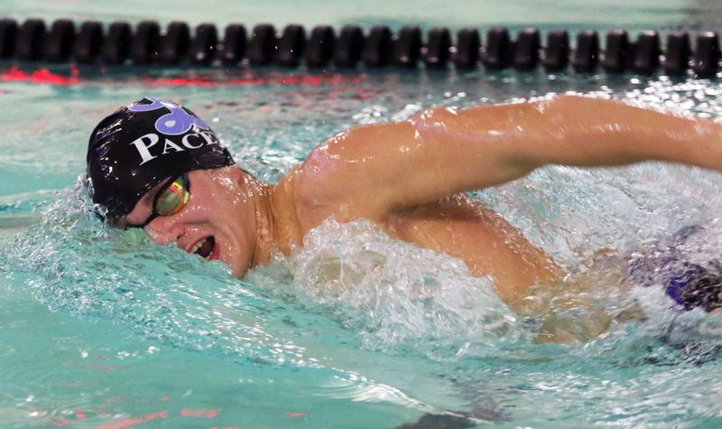 PMG PHOTO: DAN BROOD - Lakeridge senior Jay Heymann swims to victory - and a school record - in the 200-yard freestyle during his team's 121-49 win over Tigard at Tigard Aquatic Center on Thursday, Dec. 12.
