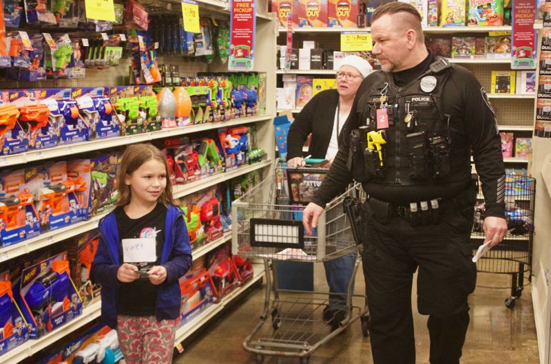 PMG PHOTO: CHRISTOPHER KEIZUR - Greshams Shop with a Cop Saturday, Dec. 14, is a chance to spread holiday cheer to local children.