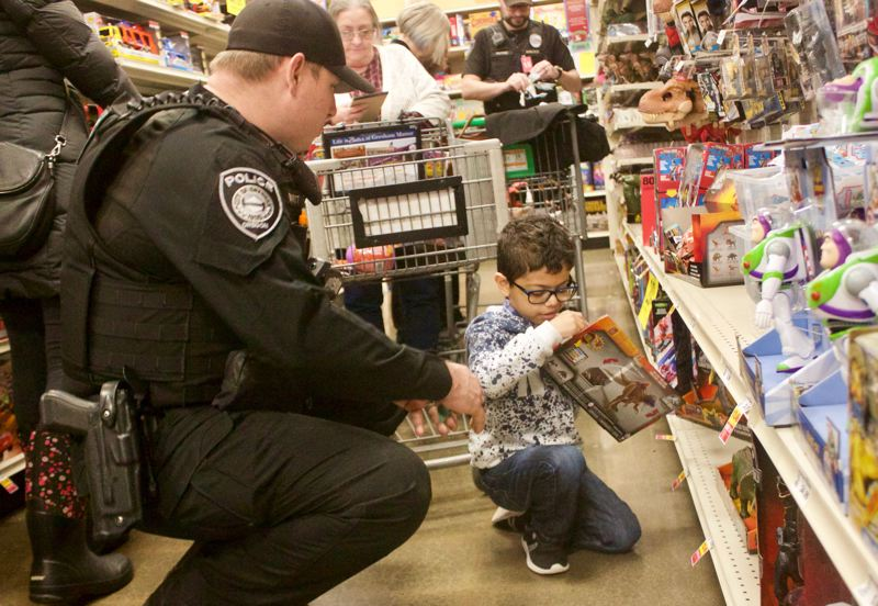 PMG PHOTO: CHRISTOPHER KEIZUR - Gresham Police Chief Robin Sells said her favorite part of Shop with a Cop is seeing the officers scrunched down in the aisles.