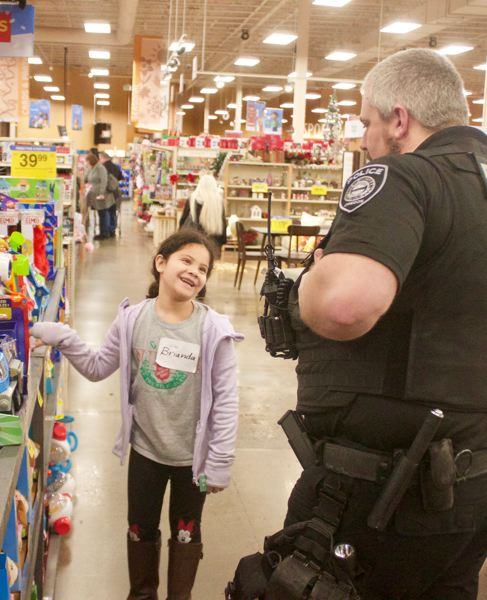 PMG PHOTO: CHRISTOPHER KEIZUR - During Shop with a Cop, the kids not only buy toys and games for themselves, but also gifts for their families.