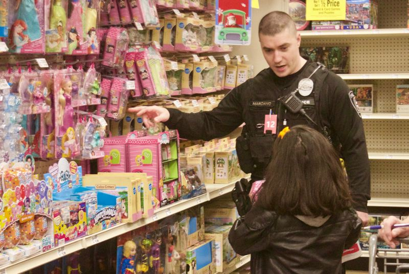 PMG PHOTO: CHRISTOPHER KEIZUR - Officer Dan Marciano points out some options in the toy aisle.