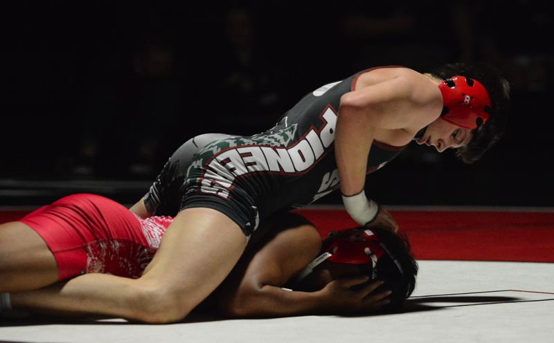 PMG PHOTO: DAVID BALL - Sandys Isaiah Shideler keeps his opponent on the mat during his 17-3 majority decision at 138 pounds Thursday against Centennial.