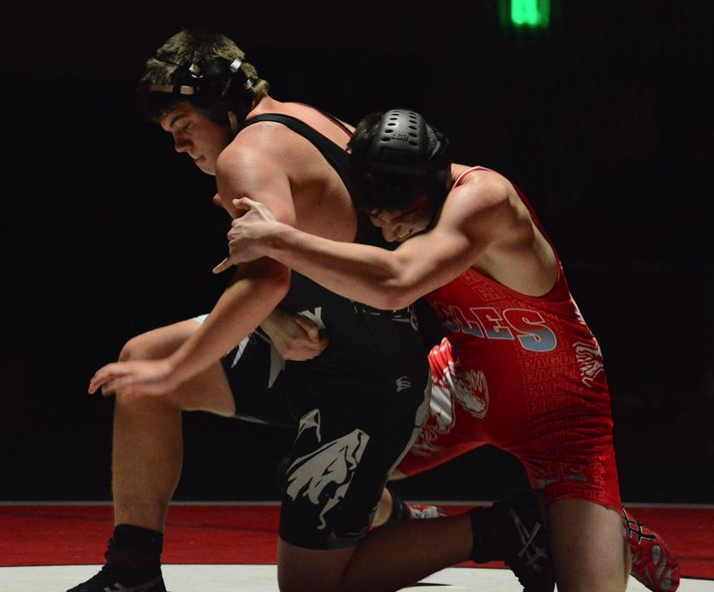 PMG PHOTO: DAVID BALL - Sandys Malik Treanor looks to get to his feet during a loss to Centennials Riley Salazar at 152 pounds.