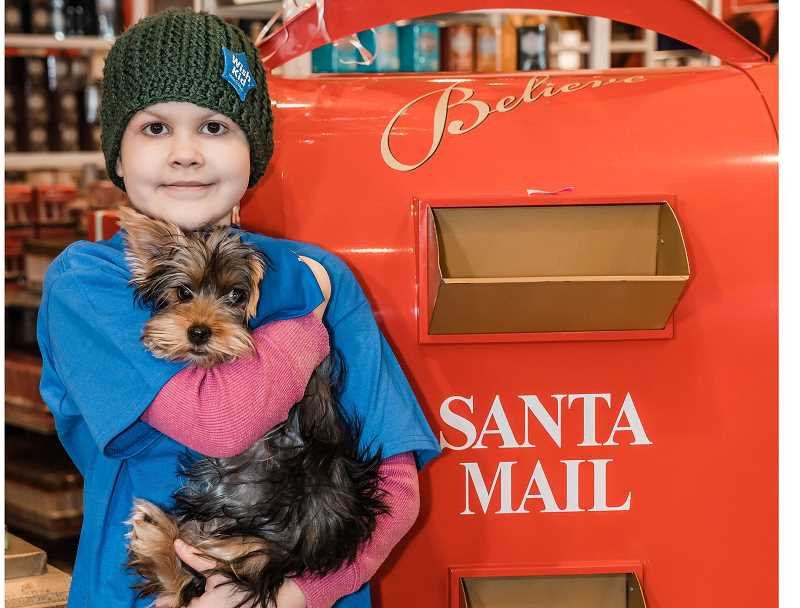 COURTESY PHOTO: MONROE PHOTOGRAPHY - After meeting her new Yorkie puppy Jasmine, Mabel Lord wrote letters to Santa as part of Macy's Believe Campaign.