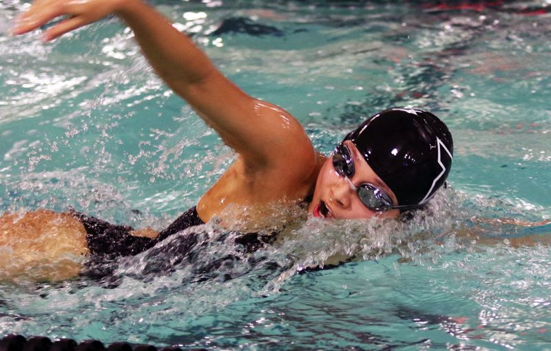 PMG PHOTO: DAN BROOD - Tigard's Shannon Liang picked up a victory in the 100-yard freestyle event in the Tigers' Three Rivers League dual meet with Lakeridge. Liang also won the 100 backstroke.