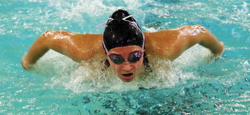 PMG PHOTO: DAN BROOD - Tigard High School sophomore Abbigale Elliott took second place in the 100-yard butterfly event during the Tigers' league meet with Lakeridge.