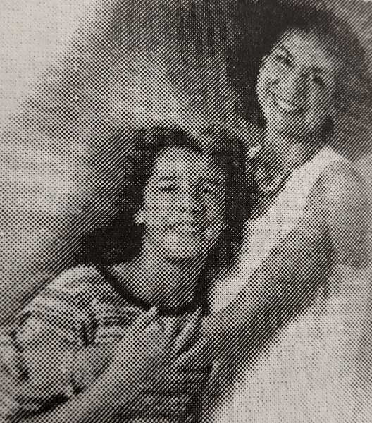 ARCHIVE PHOTO - In 1999, Regina Ortiz-Shepard, a 1981 graduate of Estacada High School, learned that she and her daughter, Lauren, 11, would be featured in the Red Cross calendar for the following year.