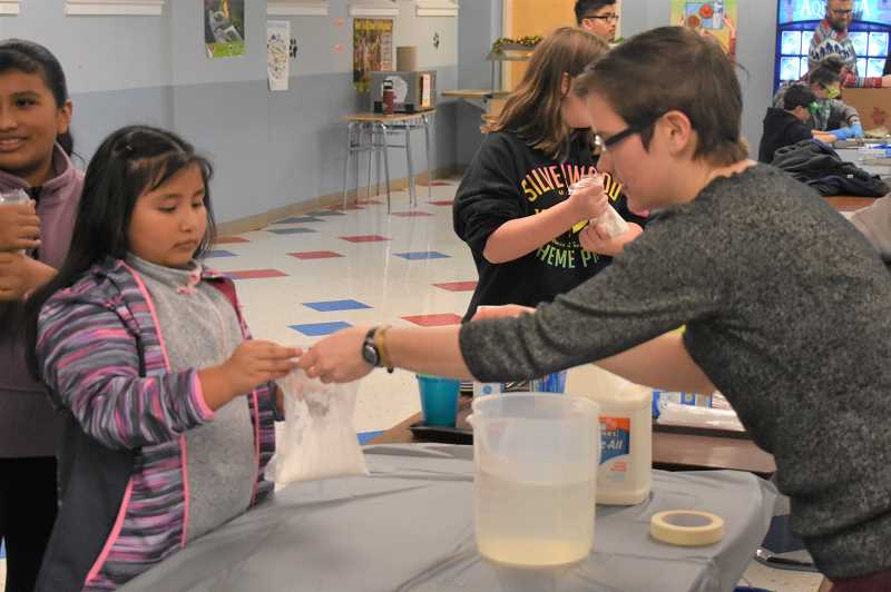 PMG PHOTO: EMILY LINDSTRAND - Students worked on a variety of hands-on experiments during Estacada Middle School's science night last week.