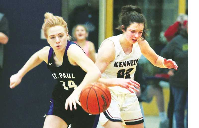 WOODBURN INDEPENDENT PHOTO: PHIL HAWKINS - St. Paul senior Isabelle Wyss strips Kennedy junior Ellie Cantu on the final possession of Saturday's championship game of the Kennedy Holiday Classic, preventing the Trojans from getting up a potential game-winning shot.