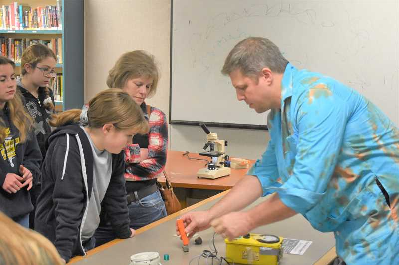 PMG PHOTO: EMILY LINDSTRAND - Students watch a demonstration during Estacada Middle School's science night.