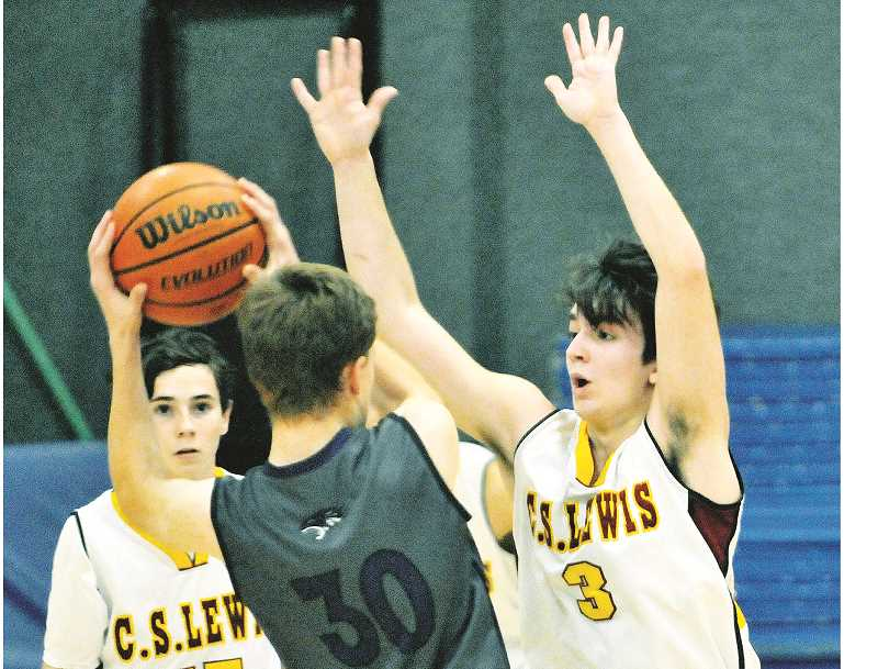 GRAPHIC PHOTO: GARY ALLEN - The C.S. Lewis boys basketball team includes two seniors, two juniors, two sophomores and two freshman and is rebuilding after a couple of successful years of 1A play.