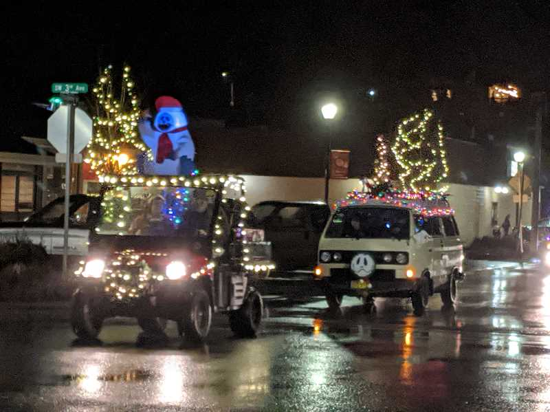 PMG PHOTO: EMILY LINDSTRAND - Vehicles in the Estacada Holiday Light Parade were decorated with bright lights and snowmen.