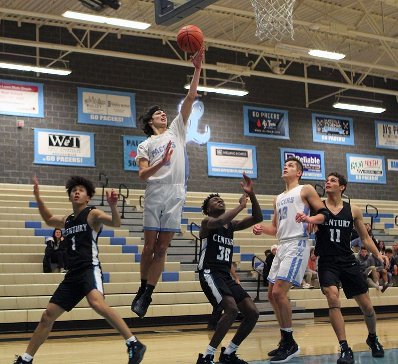 PMG PHOTO: MILES VANCE - Lakeridge senior guard Carson Mike goes to the basket to score during his team's 63-59 win over Century at Lakeridge High School on Tuesday, Dec. 17.
