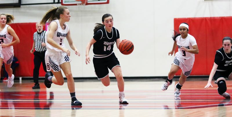 PMG PHOTO: DAN BROOD - Tigard High School freshman Hailey Shimojima (14) rushes the ball up court after coming up with a steal in overtime during Tuesday's game at Westview. Shimojima's 3-pointer gave the Tigers a 47-46 win.