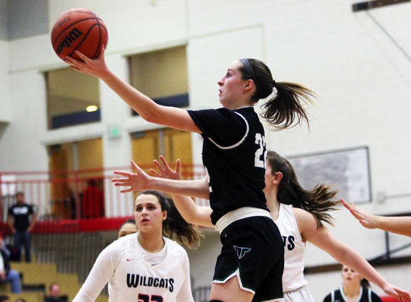 PMG PHOTO: DAN BROOD - Tigard High School senior Delaney Leavitt goes up to the basket during the third quarter of the Tigers' 47-46 overtime win at Westview on Tuesday.