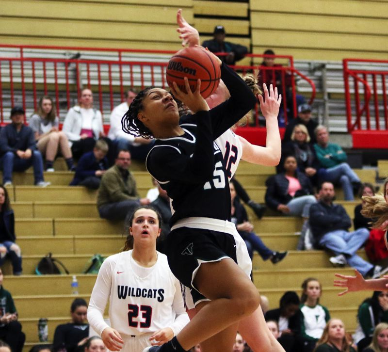 PMG PHOTO: DAN BROOD - Tigard High School junior Ajae Holdman goes up to the basket during the Tigers' 47-46 overtime win at Westview on Tuesday.