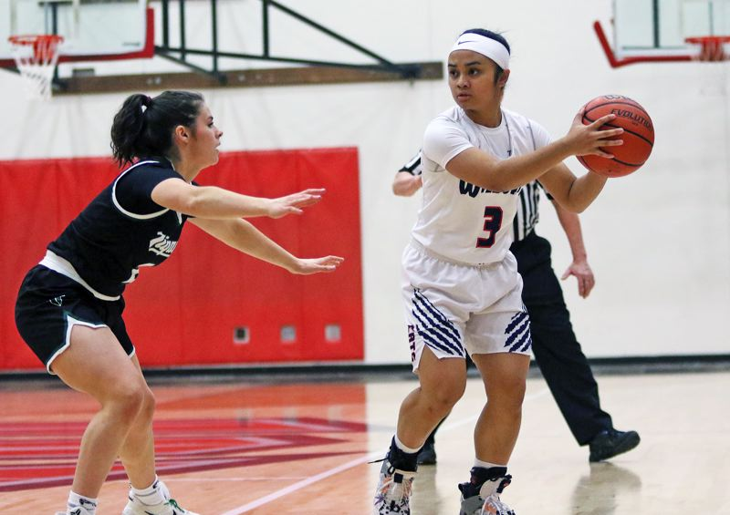 PMG PHOTO: DAN BROOD - Westview High School senior guard Danielle Llamas (right) looks to get the ball inside against Tigard senior Kennedy Brown during Tuesday's game.