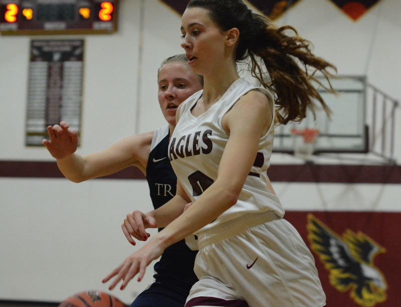 PMG PHOTO: DAVID BALL - Damascus Christians Emily Powers makes a move to the basket during the Eagles 50-24 win over Trinity Academy on Tuesday night.