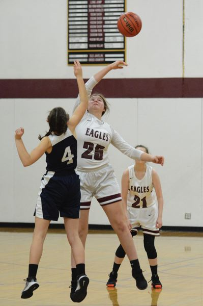 PMG PHOTO: DAVID BALL - Damascus Christians Katie Bailey wins the opening tip.