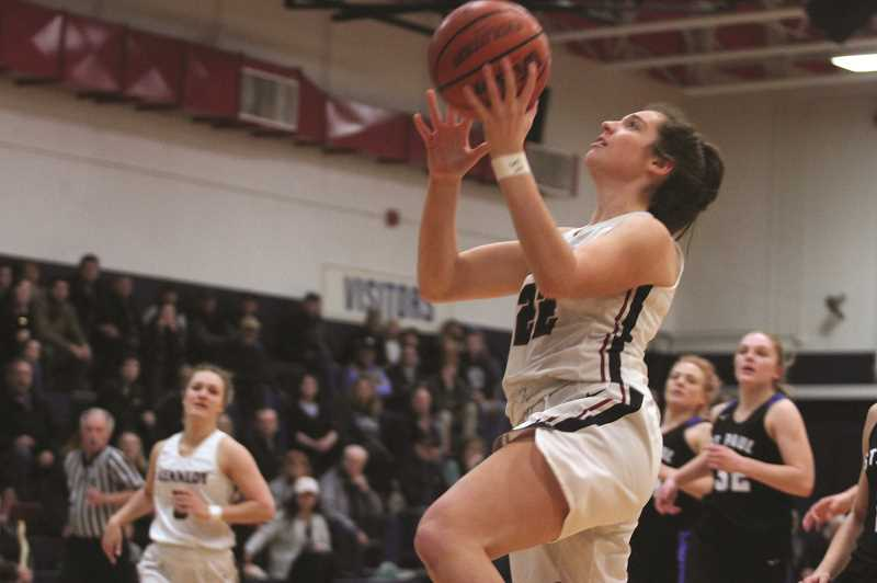 PMG PHOTO: PHIL HAWKINS - Kennedy junior Ellie Cantu provides the Trojans with a versatile post player — one with the height to challenge opposing inside players while possessing the speed and athleticism to be a two-way threat anywhere on the court.