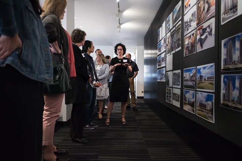COURTESY PHOTO: TVA ARCHITECTS - Mandy Butler, the architect on the DHS Gresham project, gives a tour to visitors to the TVA Architects offices in Portland.