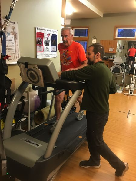 COURTESY PHOTO: JESSICA BEESLEY/NW REHABILITATION ASSOCIATES - Workouts with Mike Studer of Northwest Rehabilitation Associates in Salem have given Craig Hanneman a step up in dealing with ALS.