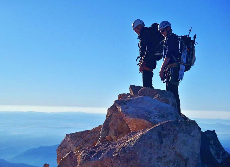 COURTESY PHOTO: BOB ALEXANDER - In 2013, Craig Hanneman (left) and Jim Walkley on summit ridge of Mount Jefferson. On the descent, Hanneman fell into a crevasse and was rescued by fellow climbers.