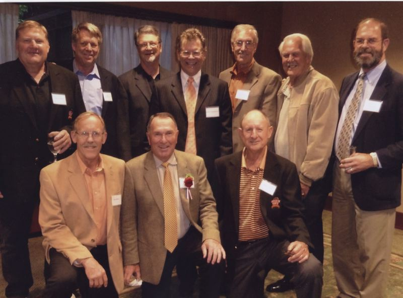 COURTESY PHOTO: BOB GILL - When Rich Brooks was inducted into the Oregon Sports Hall of Fame he was joined by guys who he coached on the Oregon State defensive line. Pictured in back row, from left: Jess Lewis, Jon Sandstrom, Mark Dippel, Scott Freeburn, Hanneman, Ron Boley, Dale Branch. Front row, from left: Bob Jossis, Rich Brooks, Mike Foote.