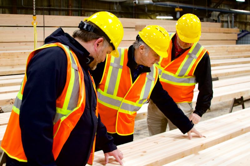 COURTESY: CLACKAMAS COUNTY - Clackamas County Commissioner Ken Humberston (center) and others from the county visited construction sites to learn about how cross-laminated timber and other mass timber materials are being used in Oregon building projects.