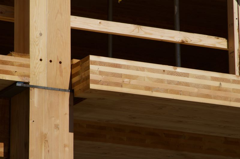 COURTESY: CLACKAMAS COUNTY - Cross-laminated timber is made by taking pieces of wood that have been glued together at 90-degree angles and compressing the material into panels that are lightweight while also being extremely strong.