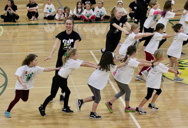 PMG PHOTOS: J. BRIAN MONIHAN - Debs perform with their students after a day of dancing.