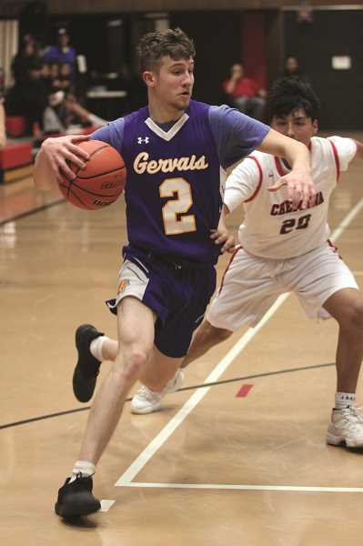 PMG PHOTO: PHIL HAWKINS - Gervais senior Alex Kalugin dropped 25 points and connected on three 3-pointers in the Cougars win over Chemawa.