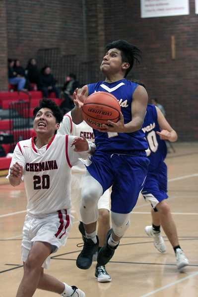 PMG PHOTO: PHIL HAWKINS - Gervais senior Daniel Hernandez scored seven points and helped run an offense that scored 60 points through the first three quarters against the Braves.