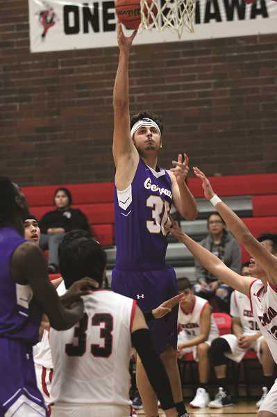 PMG PHOTO: PHIL HAWKINS - Gervais junior Auggie Guido had eight points, 11 rebounds for the Cougars, who employed a lengthy starting lineup consisting of guard Daniel Hernandez and four forwards at 6-foot-2 or taller.