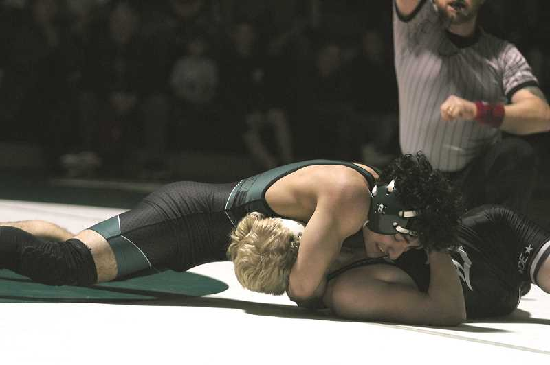 PMG PHOTO: PHIL HAWKINS - North Marion senior Oscar Olvera was one of two Huskies to score pins in the teams dual against Dayton on Tuesday, Dec. 17. Olvera rallied from an early deficit to pin Kaiden Abell in 4:24 in the 138-pound match.