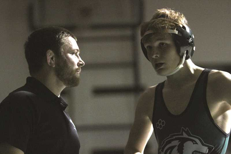 PMG PHOTO: PHIL HAWKINS - North Marion head coach Shane Sheppard speaks with sophomore Caedyn Laninga during a time stoppage.  Sheppard wants to see more one-on-one duals in the future, giving community members an easy to attend event to support the wrestling program.