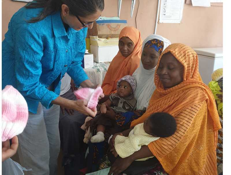 Medical professionals in Africa to give Gladstone-knit baby hats to parents as an incentive for vaccination.