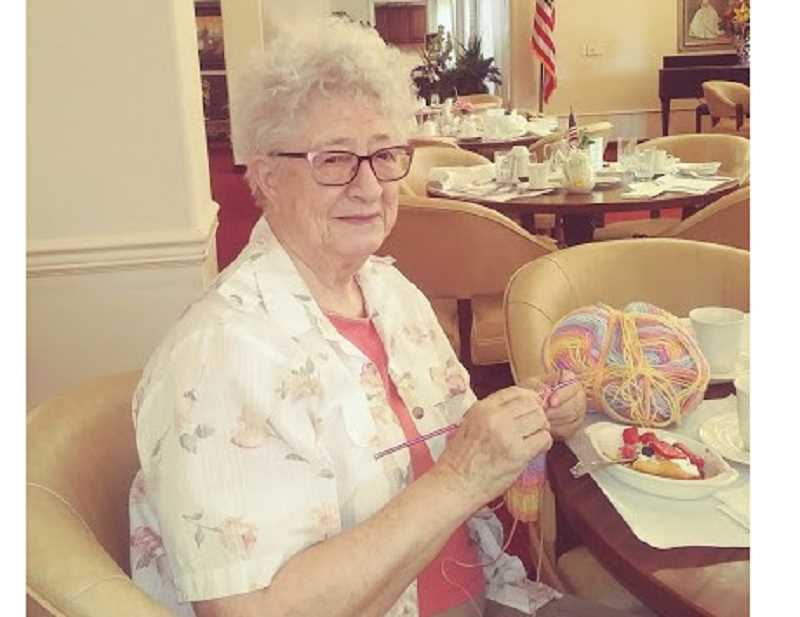 Jean Sequeira is hard at work knitting hats at Somerset Lodge on Cason Road for an African medical program.