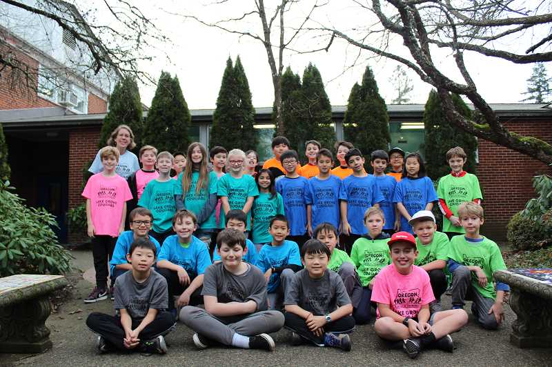 PMG PHOTO: ASIA ALVAREZ ZELLER - Lake Grove Battle of the Books teams posed for a group photo.