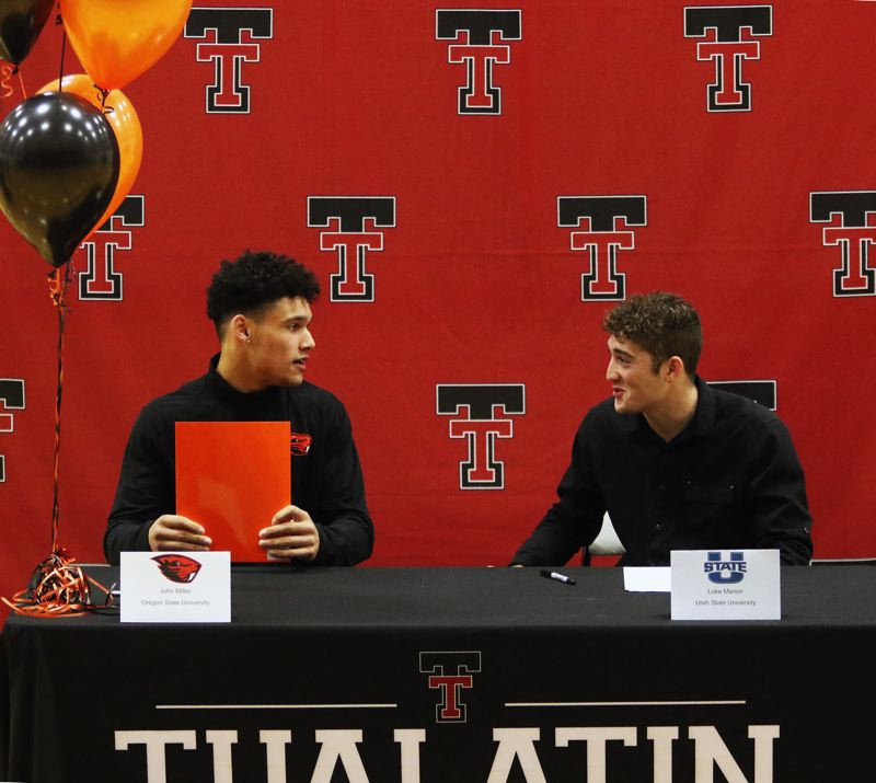 PMG PHOTO: DAN BROOD - Tualatin High School seniors John Miller (left) and Luke Marion signed their college football national letters of intent during a ceremony held at the school.