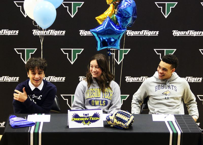 PMG PHOTO: DAN BROOD - Tigard High School seniors (from left) Marco Millan, Lexi Klum and Max Lenzy signed their college national letters of intent during a ceremony held at the school.
