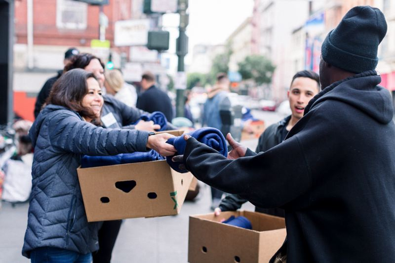 COURTESY: SACKCLOTH & ASHES - Volunteers hand out blankets to those who are homeless as part of an effort by Salem-based Sackcloth & Ashes to provide 1 million blankets to homeless shelters by 2024.o provide 1 million blankets to homeless shelters by 2024.