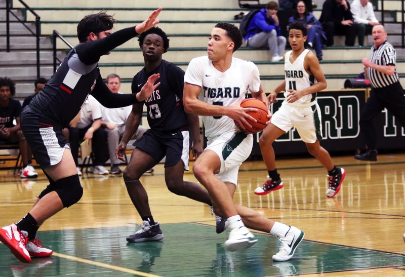 PMG PHOTO: DAN BROOD - Tigard High School junior wing Drew Carter (center) was an All-Three Rivers League first-team selection last year as a junior.