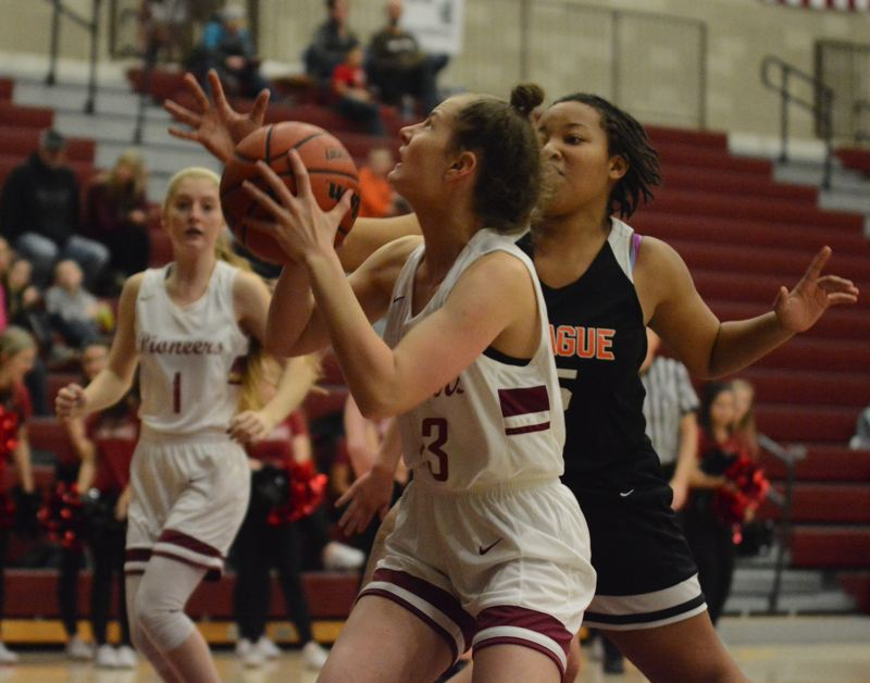 PMG PHOTO: DAVID BALL - Sandys Peyton Bradley looks for a path to the basket against Spragues Nellie Brown.