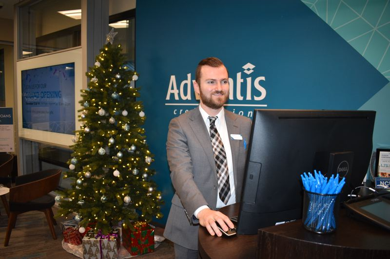 PMG PHOTO: SHANNON O. WELLS - Daniel Tomuta, senior member advisor, is the first one to greet new and longtime members at the new Advantis Credit Union branch in the Oregon Trail shopping center in Gresham.